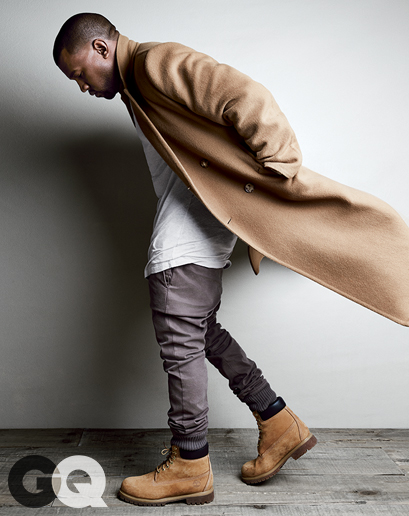 Coat, $4,995 by Calvin Klein Collection T-shirt, $290 by Balmain pants $195 by Michael Kors Boots $190 by Timberland