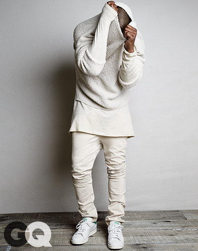Sweater, $340 and jeans, $295 by A.P.C. Kanye T-shirt, $210 by Rochambaeu Sneakers, $75 by Adidas Originals